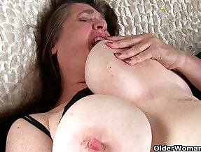 Grandma with round big tits wakes up horny