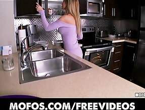 Stunning blonde teen strips in the kitchen and rubs herself to orgasm